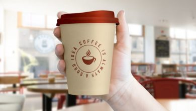Photo of Hand Holding Coffee Cup Mockup