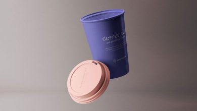 Photo of Floating Paper Coffee Cup with Plastic Lid Mockup