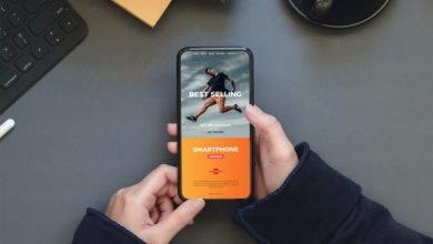 Photo of A Person Holding an iPhone Free Mockup